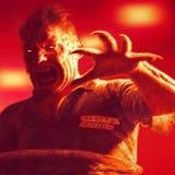 Gekke dode zombie in dwangbuis vector illustratie