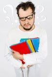 Gekke nerd met met vraagtekens Stock Afbeelding