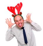 Gekke zakenman met het rendierkledij van Rudolph. Royalty-vrije Stock Afbeeldingen