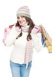 Geklede jonge vrouw met het winkelen zakken stock afbeeldingen