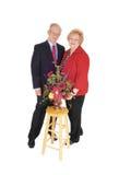 Gekleidete oben ältere Paare mit Blumen Lizenzfreies Stockfoto