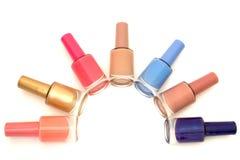Gekleurd nagellak op een witte geïsoleerde achtergrond overwhite Stock Foto