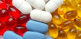 Gekleurd pillenclose-up royalty-vrije stock afbeeldingen