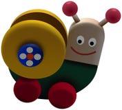 Gekleurd spiraalvormig wormstuk speelgoed op wielen Stock Afbeeldingen
