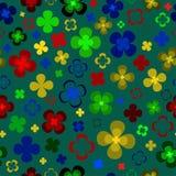 Gekleurde abstracte bloemen op een groene achtergrond stock afbeelding