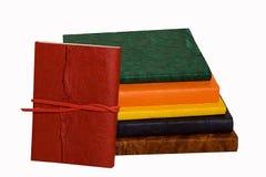 Gekleurde agenda's in een rij Stock Foto's