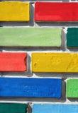 Gekleurde bakstenen muur Stock Foto's