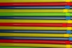Gekleurde buisjes voor drankenachtergrond royalty-vrije stock foto's