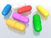 Gekleurde capsules royalty-vrije illustratie