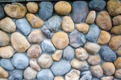 Gekleurde de textuurachtergrond van de steenmuur Stock Foto