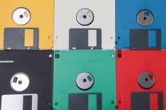 Gekleurde floppy diskachtergrond Stock Foto's