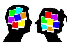 Gekleurde foto's binnen de silhouetten van hoofden Royalty-vrije Stock Foto