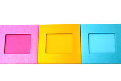 Gekleurde fotokaders in het midden op een wit Stock Foto's