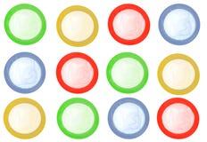 Gekleurde geïsoleerdei condomen Stock Afbeelding