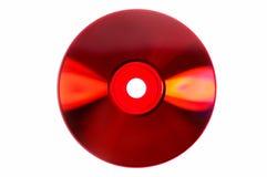 Gekleurde glans op rode CD/DVD die op wit wordt geïsoleerdw Stock Afbeeldingen