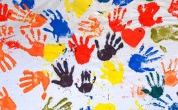 Gekleurde Handen Stock Afbeelding