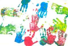 Gekleurde handenaf:drukken Stock Foto's