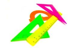 Gekleurde heersersclose-up op wit Stock Foto's
