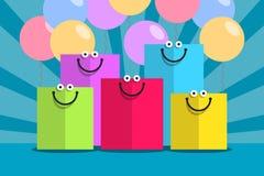 Gekleurde het winkelen zakken en glimlachen Stock Foto's