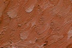 Gekleurde penseelstreken van bruine olieverf op canvas Royalty-vrije Stock Foto