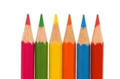 Gekleurde potloden die op de witte achtergrond worden geïsoleerdw Stock Foto