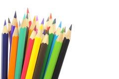 Gekleurde potloden die op wit worden geïsoleerdt Stock Foto