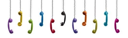 Gekleurde uitstekende telefoons Stock Foto