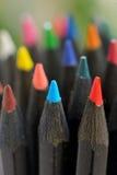Gekleurde zwarte potloden Stock Foto's
