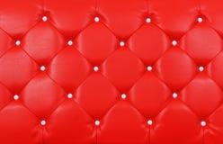 Geknöpft auf der roten Beschaffenheit. Wiederholen Sie Muster Lizenzfreie Stockfotografie