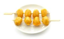 Geknepen gouden eierdooiers royalty-vrije stock fotografie