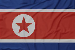 Geknitterte Flagge Nordkoreas stockbilder