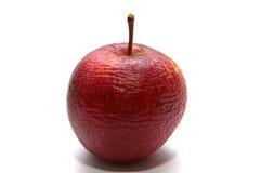 Geknitterter Apfel getrennt auf weißem Hintergrund Stockbild