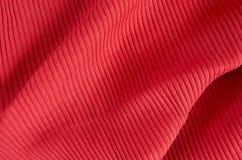 Geknitterter roter Gewebehintergrund Stockbilder