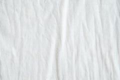 Geknitterter weißer Baumwollgewebe-Beschaffenheitshintergrund, Tapete Stockbilder