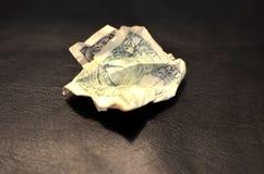 Geknittertes Dollarschein US ein Dollarscheinhintergrund Geldbeschaffenheitsanmerkungen entwerfen stockbild