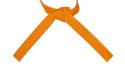 Geknoteter Karate-Orangen-Gurt stockfotos