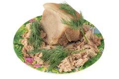 Gekochtes Schweinefleisch auf einer Platte mit Dill Stockfotografie