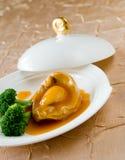 Gekookte abalone en groente Stock Afbeeldingen