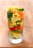 Gekookte wortelen suikermaïs en broccoli Royalty-vrije Stock Foto's