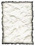 Gekrümmtes, gesprenkeltes Papier mit gebranntem Rand Stockfoto