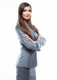 Gekreuzte Arme der Geschäftsfrau gegen weißen Hintergrund Stockbilder
