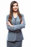 Gekreuzte Arme der Geschäftsfrau gegen weißen Hintergrund Lizenzfreie Stockbilder