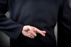 Gekreuzte Finger Stockbild