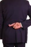 Gekreuzte Finger nach zurück Lizenzfreie Stockfotos