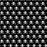 Gekreuzte Knochen und Schädelmuster auf schwarzem Hintergrund Lizenzfreies Stockfoto