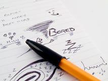 Gekritzel-Skizzen auf Arbeits-Büro-Notizblock der Sitzung Lizenzfreie Stockbilder