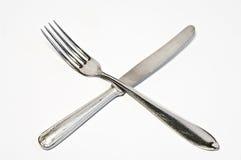 Gekruist vork en mes Royalty-vrije Stock Afbeelding