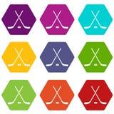 Gekruiste hockeystokken en de vastgestelde kleur van het puckpictogram hexahedron Royalty-vrije Stock Afbeeldingen