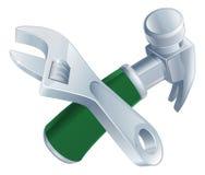 Gekruiste moersleutel en hamerhulpmiddelen Royalty-vrije Stock Foto's