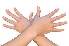 Gekruiste vrouwelijke handen met uitgerekte vingers Stock Afbeelding